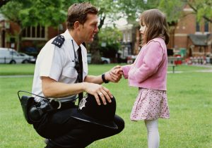 Officer talking to young girl