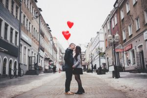 Couple met on Dating App kissing between urban street