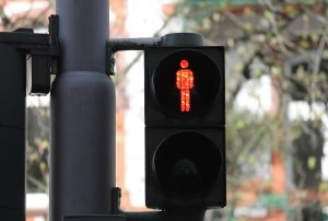 Red traffic light telling pedestrians not to walk
